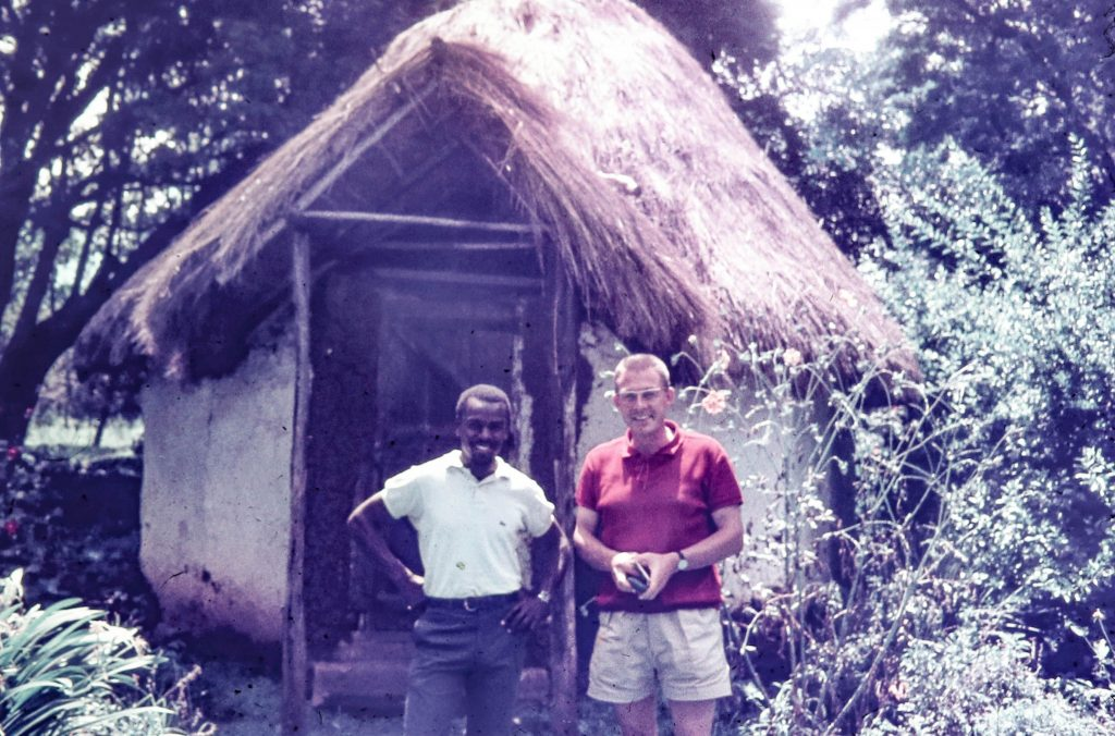 Rolf, my German friend and housemate in front of a Kenyan hut in our backyard